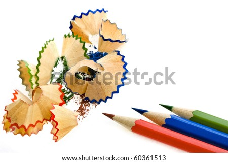 Color pencils and sharpener shaving - stock photo