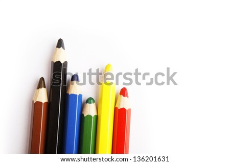Color pencils arranged in color on white background