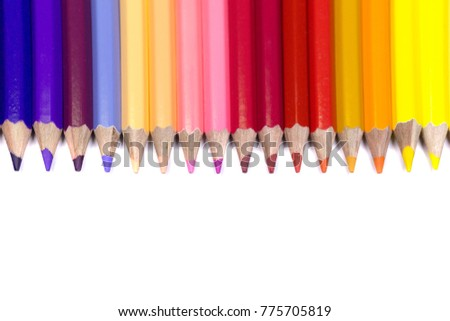 Color Pencils Facing Down on Pure White Background in Straight Line.