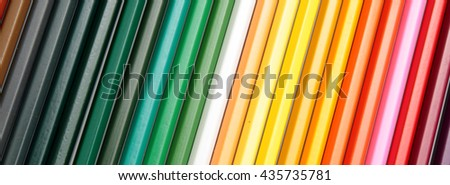 Color pencils form abstract lines pattern - stock photo