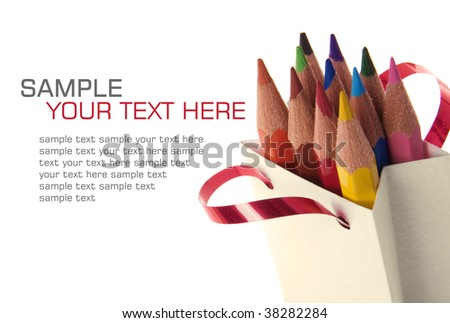 Color pencils in a bag on a white background - stock photo