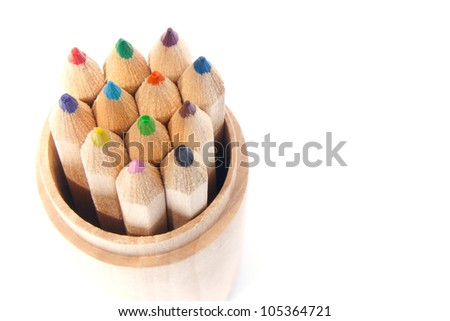 Color pencils in a box isolated on white