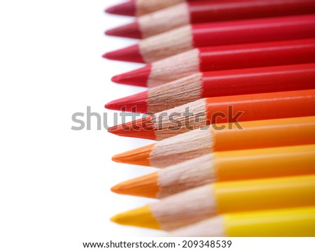 Color pencils in a row, isolated on white, shallow dof - stock photo