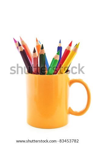 Color pencils in a yellow cup - stock photo