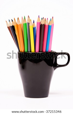 Color pencils in black jar - isolated - stock photo