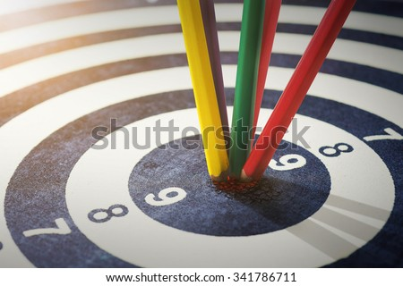 color pencils in bull's eye Success hitting target aim goal achievement concept background - stock photo