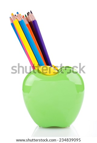 color pencils in green apple shaped holder isolated on white - stock photo