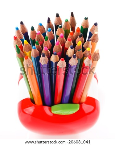 color pencils in red apple shaped holder isolated on white - stock photo