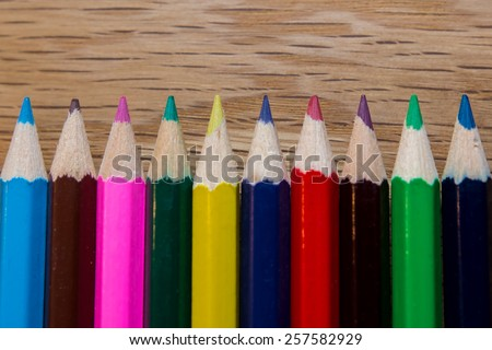 Color pencils in straight line, education concept.