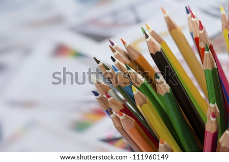 Color pencils isolated on drawing papers background close up