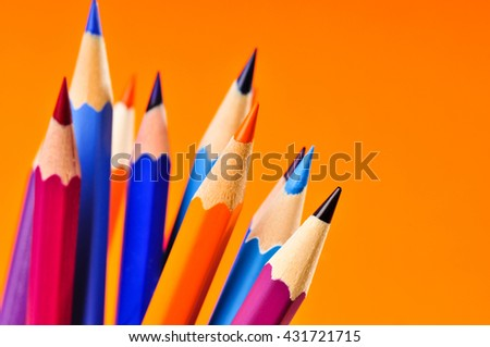 Color pencils isolated on orange background. - stock photo