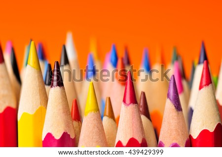 Color pencils isolated on orange background.Close up. - stock photo