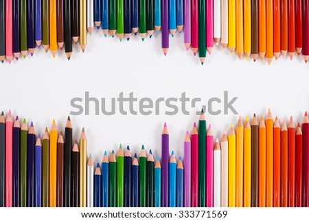 Color pencils isolated on white background close up - stock photo