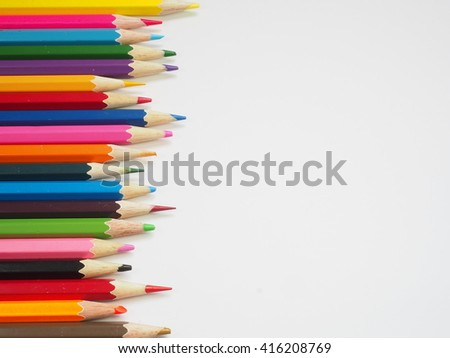 Color pencils isolated over white background close up - stock photo