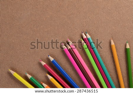 Color pencils on a board. School concept - stock photo