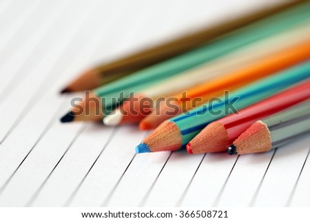 Color Pencils on Blank Paper, illustrating Concept of Creativity and Art Production
