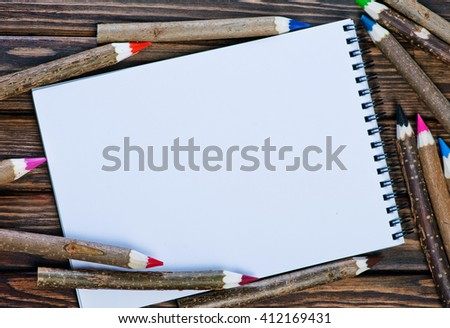 color pencils on the wooden table, pencils on a table - stock photo
