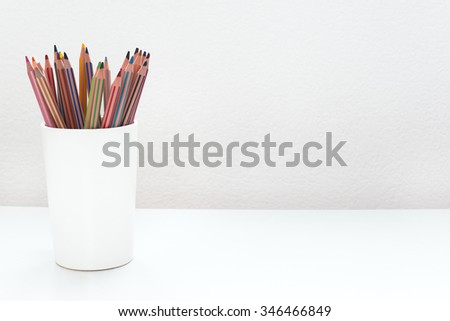 Color pencils on white desk background / With copy space for your text and design - stock photo