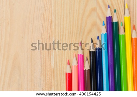 color pencils on wood table background vintage color tone, artist school concept. - stock photo