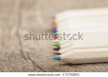 Color pencils over wooden background - stock photo