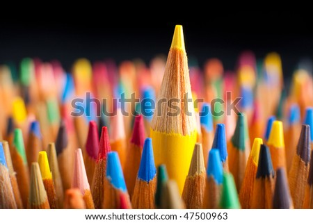 Color pencils representing the concept of Standing out from the crowd - stock photo