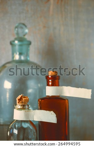 Color pharmacy dishes with labels and a large bottle of laboratory
