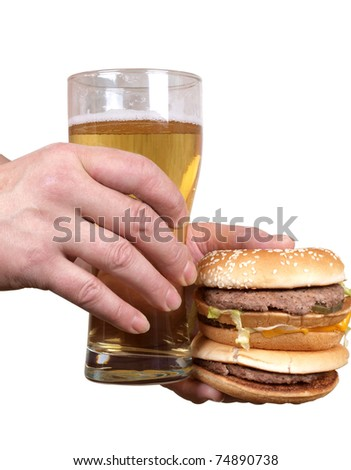 Color photo of a fat man with a hamburger and beer in his hand - stock photo