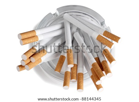 Color photo of a glass ashtray and cigarette