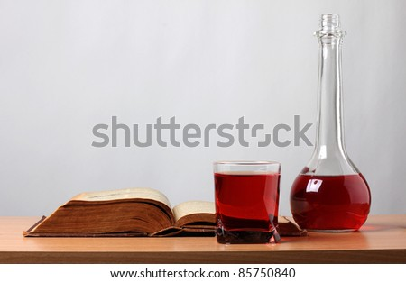 Color photo of a glass of wine and book - stock photo
