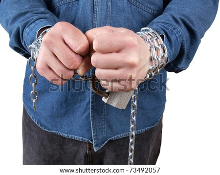 Color photo of a prisoner with a chain on his hands