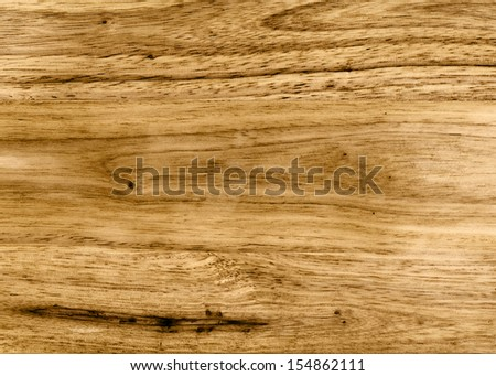 Color photo of a rough wooden surface. Very fine wood background texture.