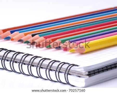 Color photo of a set of pencils on notepad