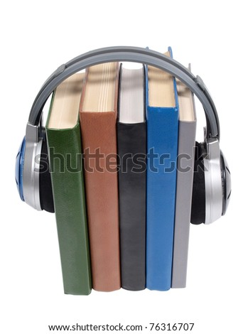Color photo of a stack of books and headphones