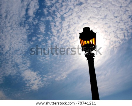 Color photo of a street lamp against sky - stock photo