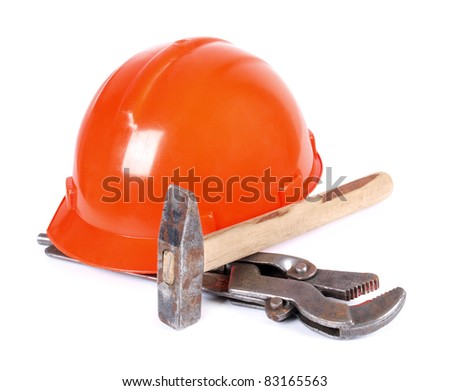 Color photo of a wrench and helmet