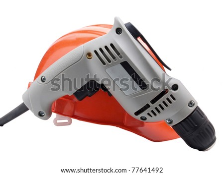 Color photo of an electric drill and helmet