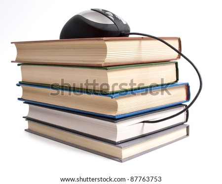 Color photo of an stack books and mouse - stock photo