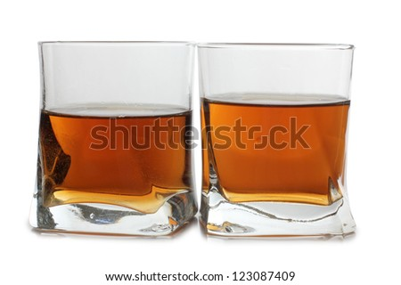 Color photo of glass with whiskey shots