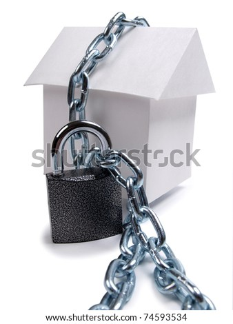 Color photo paper model house and padlock - stock photo