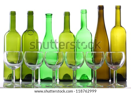 Color photograph of empty glasses of wine and bottle - stock photo