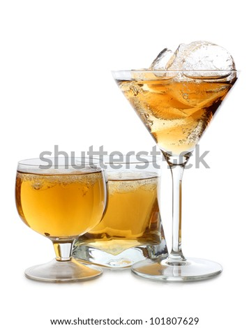 Color photograph of glasses of whiskey with ice - stock photo