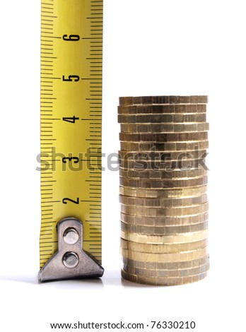 Color photograph of measuring ruler and a stack of coins - stock photo