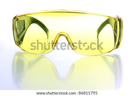 Color photograph of yellow goggles - stock photo