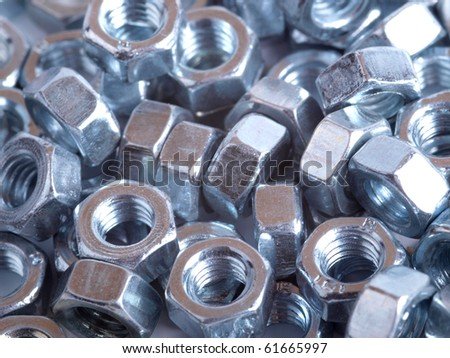 Color photograph shiny metal nuts and bolts - stock photo