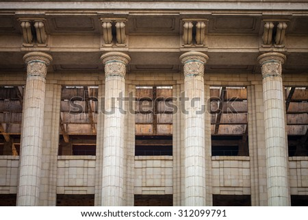 Color picture of a derelict building with big columns