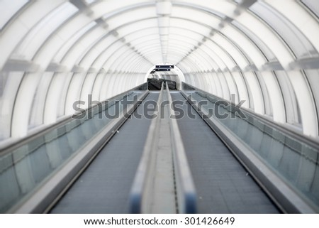 Color picture of a moving sidewalk in a tunnel - stock photo