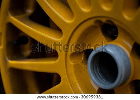 color picture of a yellow sport car rim