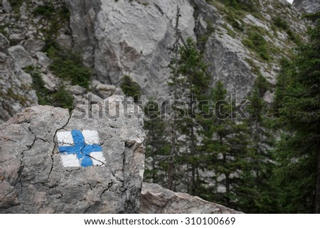 Color picture of an orientation sign for trekking tourists in the mountains - stock photo