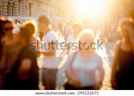Color picture of blurred town scene at sunset - stock photo