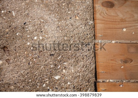 Color picture of boardwalk path in sand on beach closeup